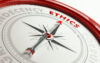 Ethics Concept: Arrow Of A Compass Pointing Ethics Text